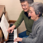 Senior adult learning to play the piano