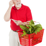 Senior man shopping for groceries looking forgetful