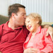 Senior woman gets a kiss from her loving adult son