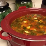 minestrone soup in a red slow cooker