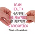 2 hands holding white puzzle pieces
