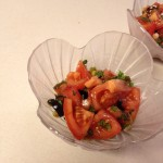 marinated tomato salad in a scalloped bowl