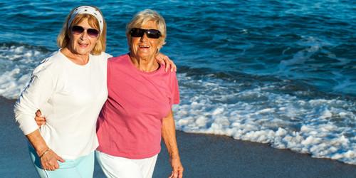 Portrait of two female friends in casual sportswear outdoors.