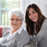 Closeup of elderly woman with female geriatric care manager